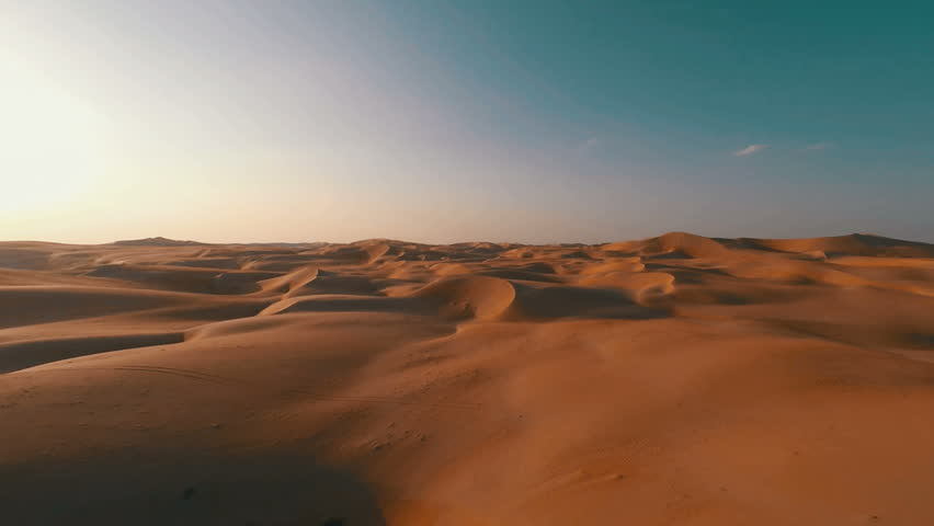 Flying backwards over picturesque sand dunes in the Arabian desert #12046013