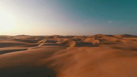 Flying backwards over picturesque sand dunes in the Arabian desert
