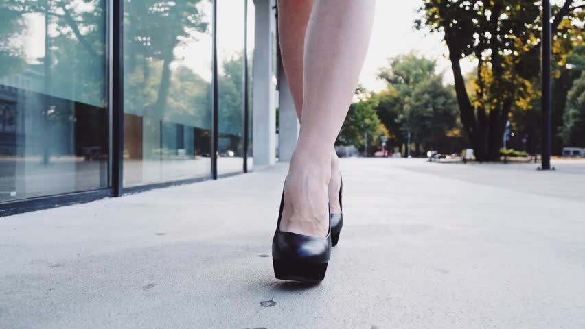7dfee608db6 Sexy woman legs in black high heels shoes walking in the city urban street.  Steadicam stabilized shot in Slow motion. Female legs in high-heeled shoes  in ...