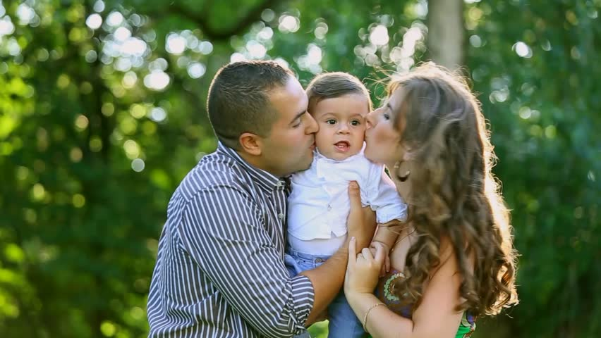 Beautiful Happy Family Posing For Photographer At Trees Background - 10 portrait photos of people before after the photographer kissed them