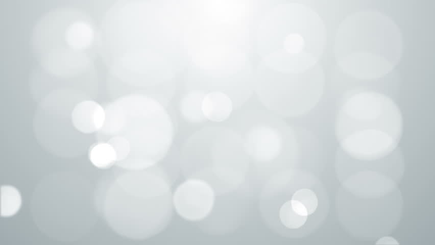 Grey bokeh lights looped animated abstract background.
