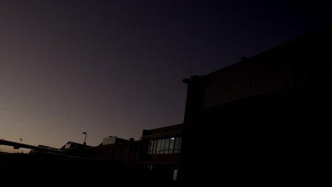 Low angle dusk/night shot of parked private jet (Cessna Citation)