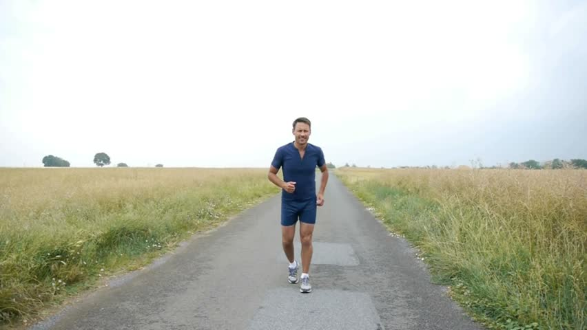 Man jogging on country road