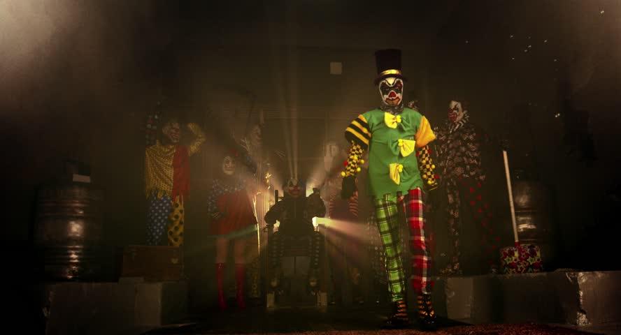 A group of clowns. Two clown acrobat dance break dance. Halloween party.   Shutterstock HD Video #12148703