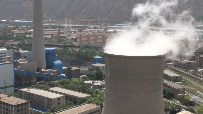 A coal fired powerplant stands in the middle of a residential area in the Chinese provincial capital of Lanzhou.