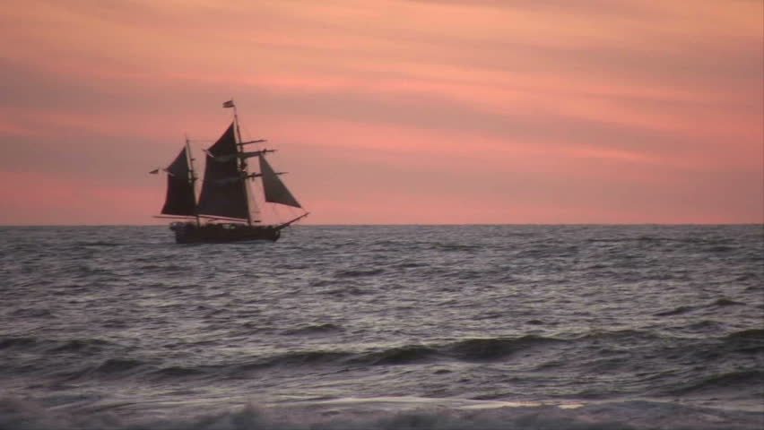 Ship Sailing On The Ocean At Sunset Image