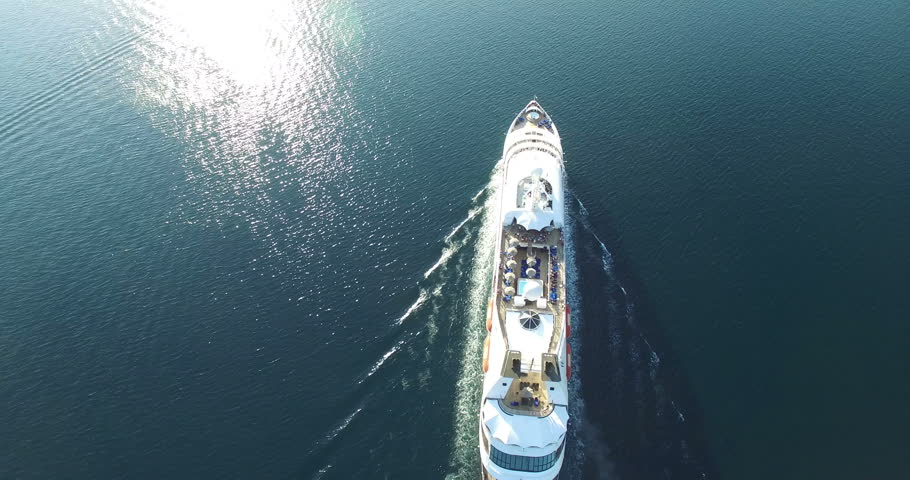 Aerial view of luxury medium cruise ship sailing from port on sunrise through the bay | Shutterstock HD Video #12161846