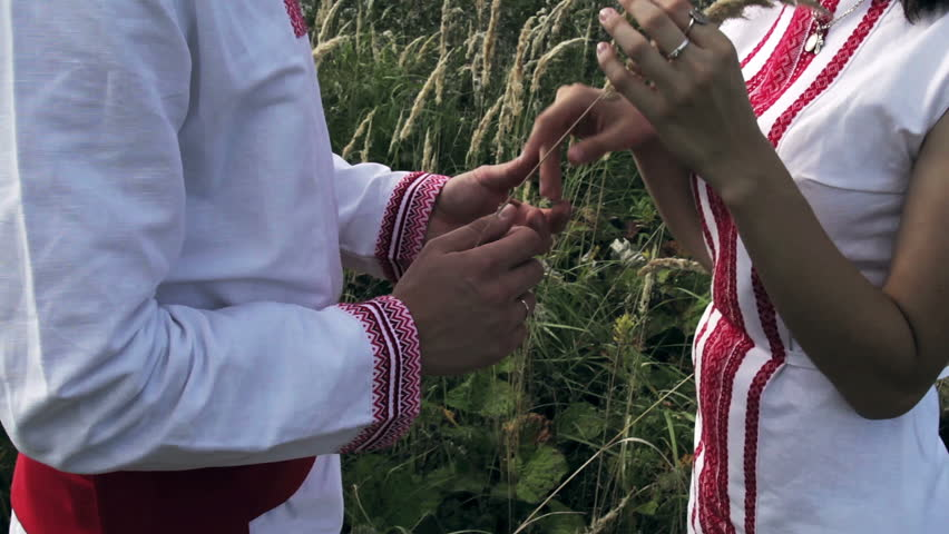 Loving couple in Russian folk costumes are holding spike HD | Shutterstock HD Video #12186923