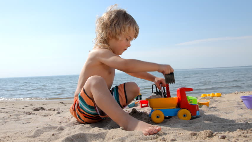 little child playing with toy truck and bulldozer on the beach hd stock video clip - Little Kid Pictures