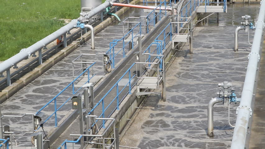 Wide angle shot of a small local waste water treatment facility for organic pre-cleaning of sewage waters.    Shutterstock HD Video #1221235