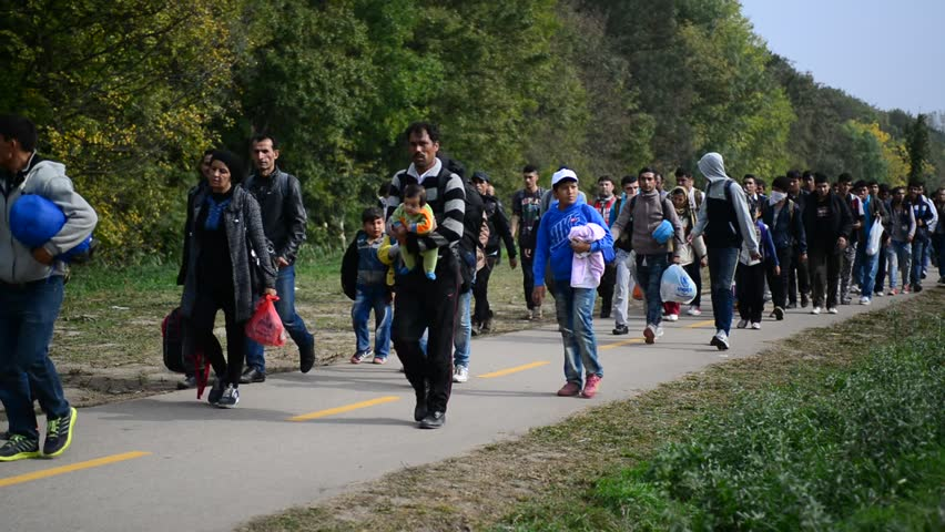 Big group of refugees leaving Hungary and going into Austria. They came to Hegyeshalom by train. These refugees are from Syria, Iraq and Afghanistan. October 6, Hegyeshalom, Hungary