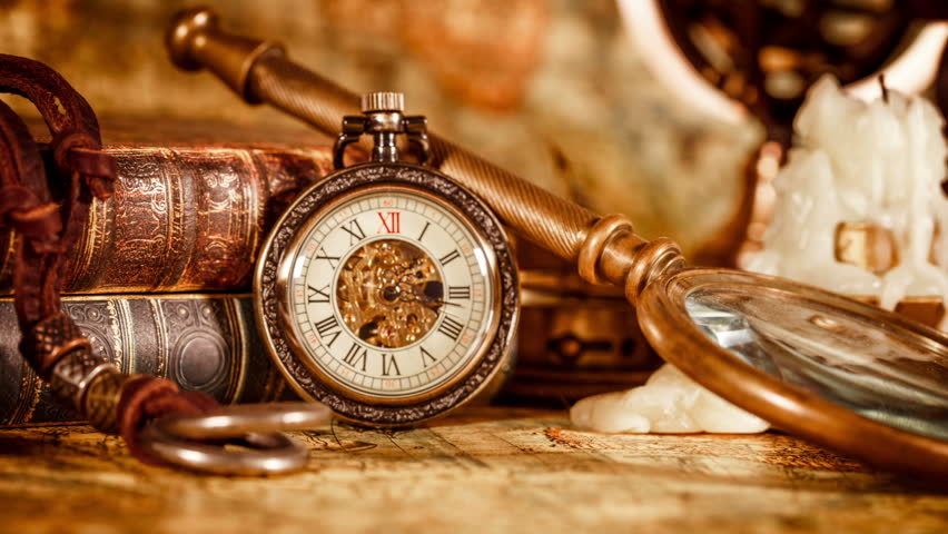 Vintage book compass telescope and a pocket watch lying on vintage antique pocket watch on the background of old books hd stock video clip gumiabroncs Choice Image