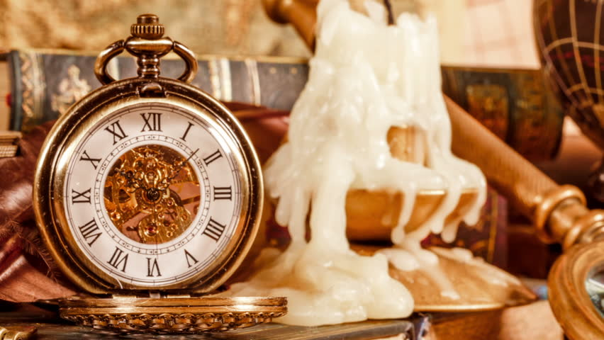 Vintage book compass telescope and a pocket watch lying on ancient vintage antique pocket watch on the background of old books hd stock video clip gumiabroncs Image collections