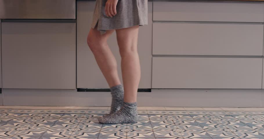 Dancing woman in kitchen moonwalk silly wearing pajamas at home having fun | Shutterstock HD Video #12270086