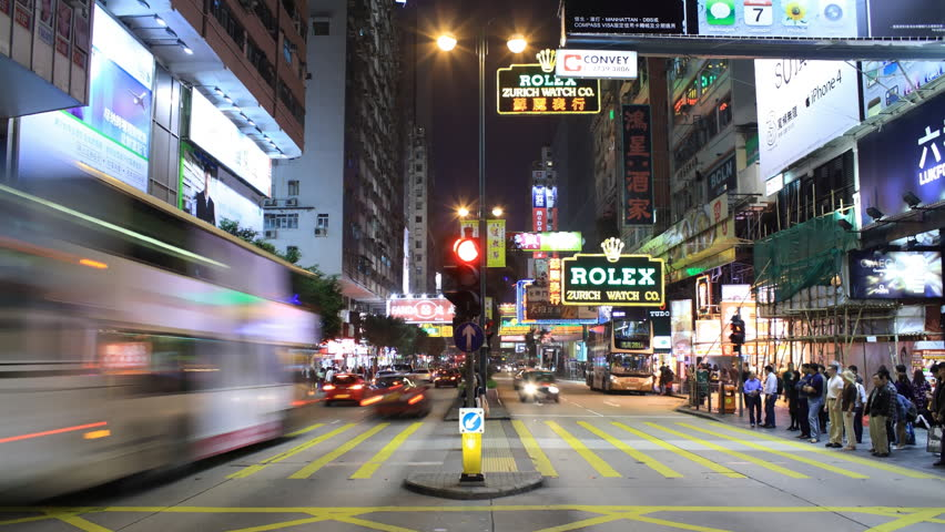 "HONG KONG - MARCH 20: Timelapse of pedestrians crossing Nathan Road at night, March 20 2011 in Kowloon, Hong Kong, China. Nathan Road is a commercial street also known as the ""Golden Mile"" and the main thoroughfare in Kowloon, Hong Kong."