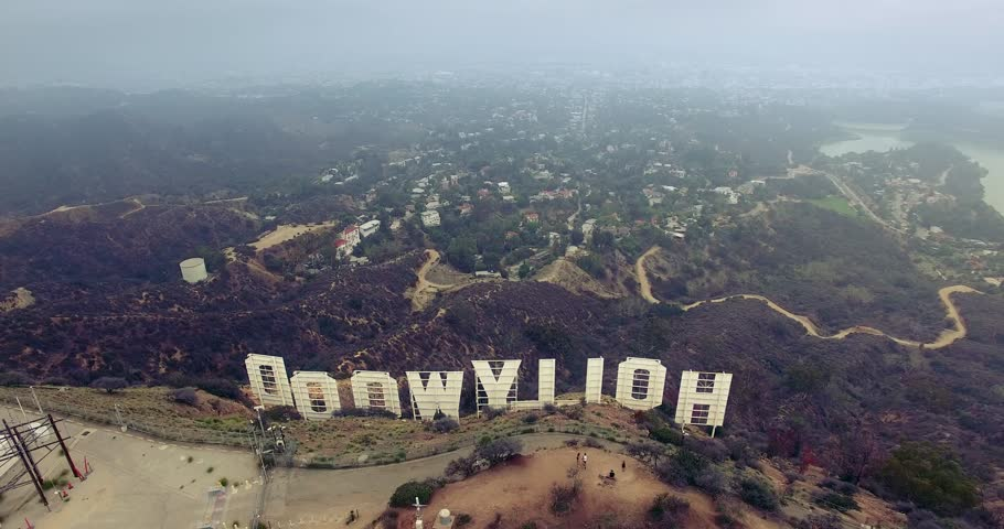 LOS ANGELES - October 2015: Aerial view of Hollywood Sign over LA cityscape on a gloomy day. 4K UHD.