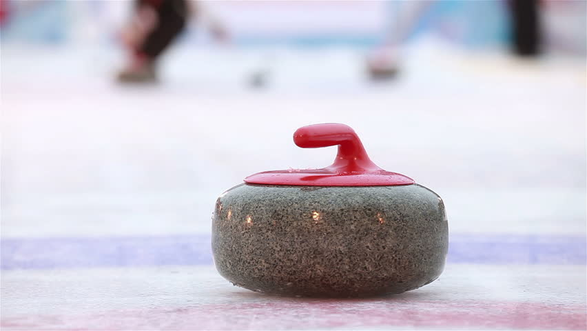 Players curling throw stones on the ice.