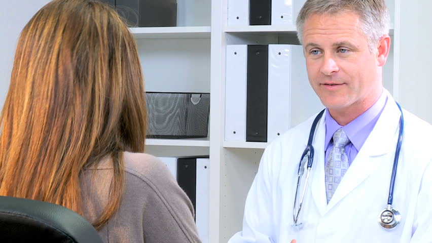 Handshake Western Caucasian male female indoors clinic meeting pharmaceutical manager medical executive clinical financial health planning   Shutterstock HD Video #12355493