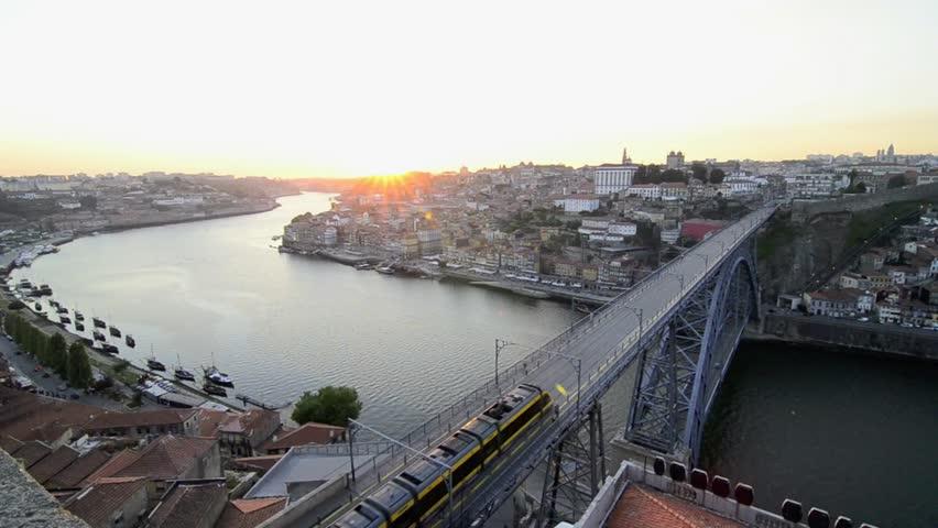 Dom Luis I bridge in Porto, Portugal at sunset.