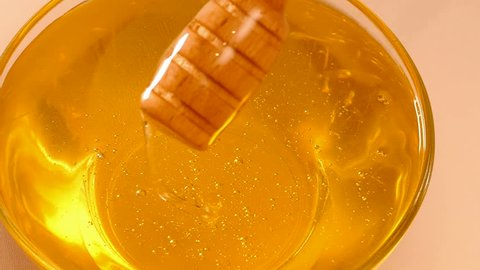 Extraction honey with a dipper in slow motion, Honey is a source of health, Slow Motion Video clip