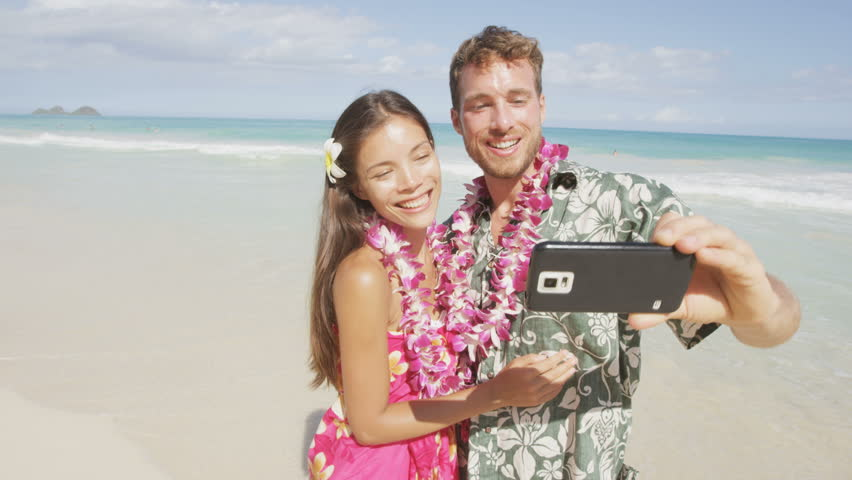 Couple On Beach Taking Selfie With Smartphone Young Woman And Man In Love Using Mobile