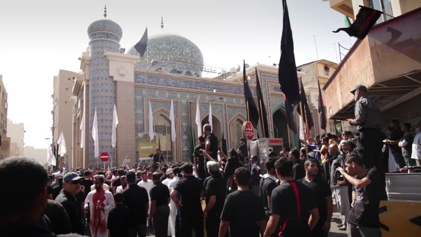Manama, Bahrain, 24 October 2015: Shiite Procession of the Day of Ashura. Mourners who where cut themselves in the forehead. Blood pouring from head wounds while beating drums and chants.