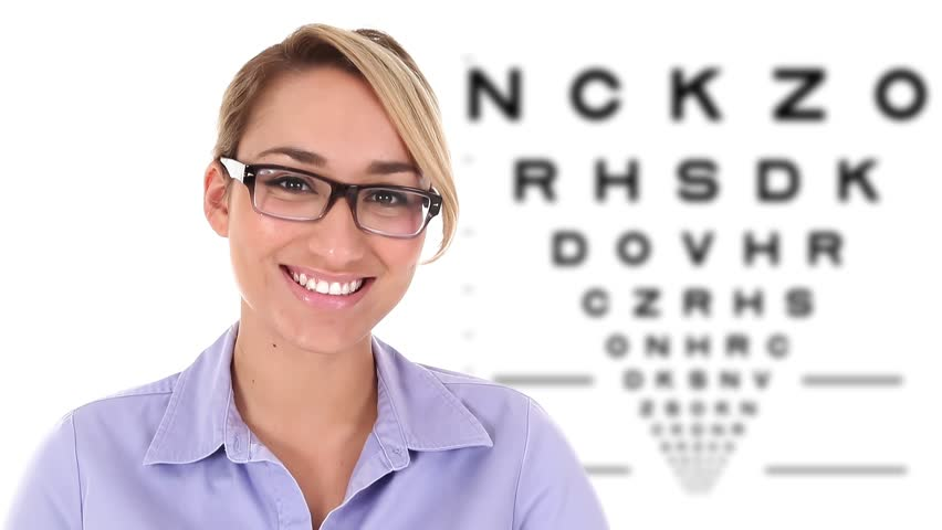 9ccc3a503669 Young Hispanic woman putting on eyeglasses with eye exam chart in the  background