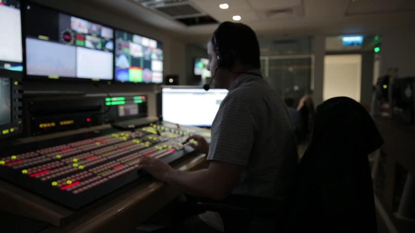 Director broadcast video mixer operation - track left