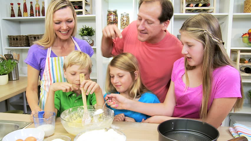 Home Kitchen Cooking caucasian family parents children son daughters cooking baking
