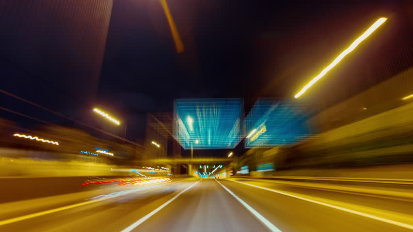 25p Driving pov modern highway timelapse/hyperlapse night, rapid speed, passing a series of tunnels.Camera outside the vehicle giving the illusion of teleporting through an series of turns,and tunnels | Shutterstock HD Video #12429323