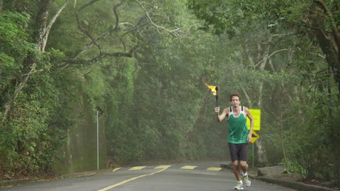 Slow motion olympic torch runner
