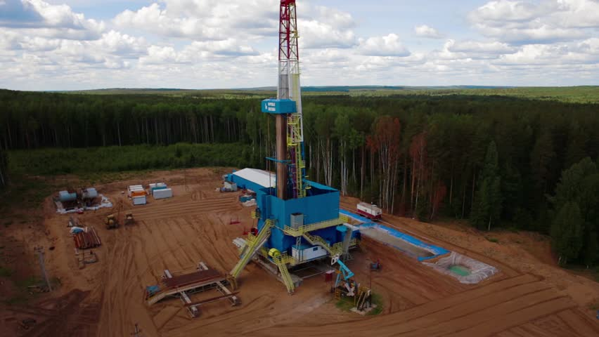 Aerial view of the oil gas drilling tower in forest