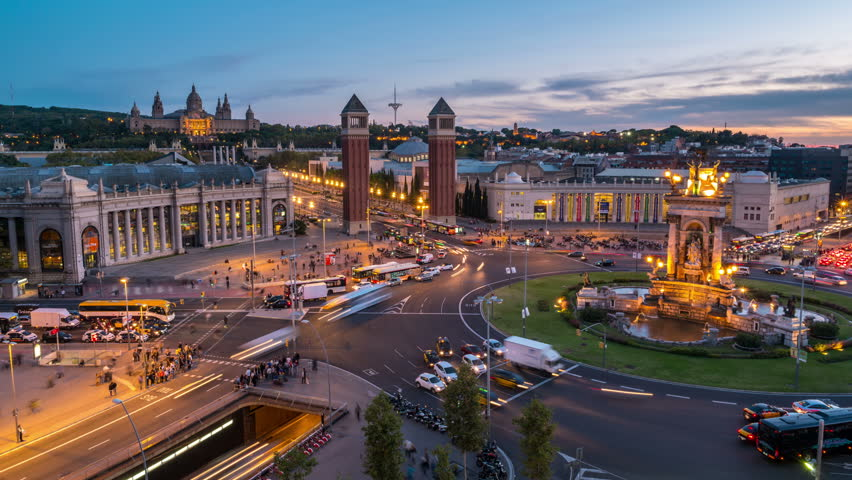 Spanish Square aerial view in Barcelona, Spain at night. This is the famous place with traffic light trails, fountain and Venetian towers, and National museum at the background. Blue sky, time-lapse  | Shutterstock HD Video #12441686