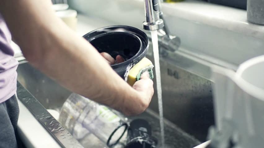Man washing dishes in kitchen