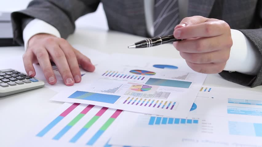 Examining business graph    | Shutterstock HD Video #1251703