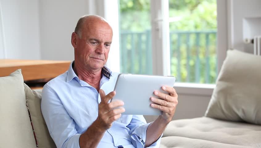 Senior Man Sitting in Sofa Video de stock (totalmente libre de ...
