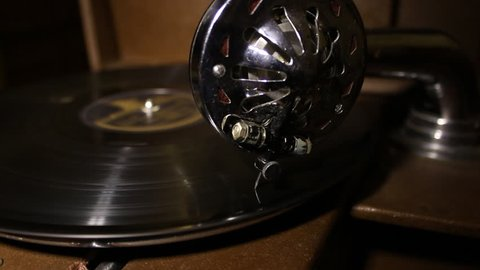 Gramophone Disc Rotates and Stops. On the old gramaphone record spinning and then stops. From gramophone hear the music