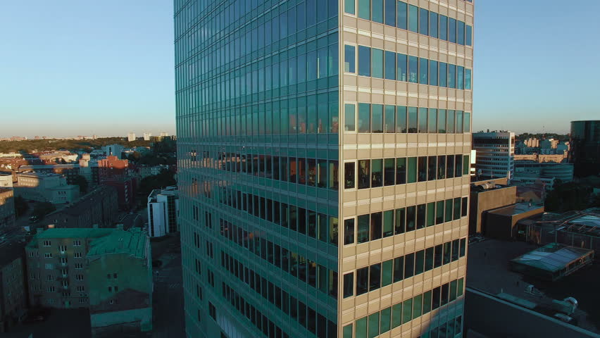 Aerial Orbit Shot of Glass Office Building in Business District. | Shutterstock HD Video #12558173