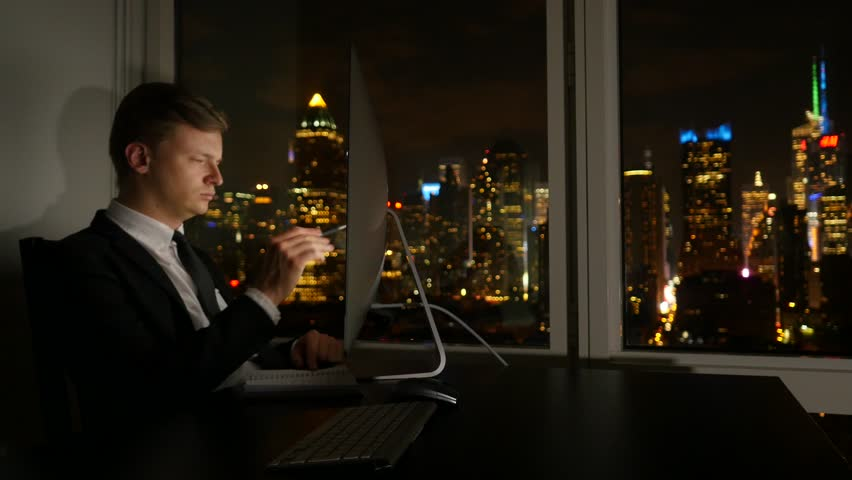 Young successful businessman working in modern office analyzing charts. business phone conversation | Shutterstock HD Video #12566543