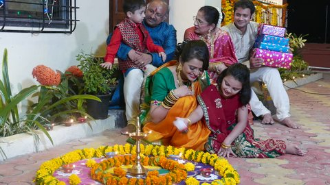 4K video footage of Indian family in traditional outfits celebrating Diwali or deepavali, festival of lights at home.