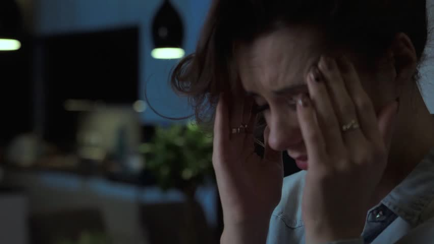 Night. Sad depressed woman at home. Headache #12594383