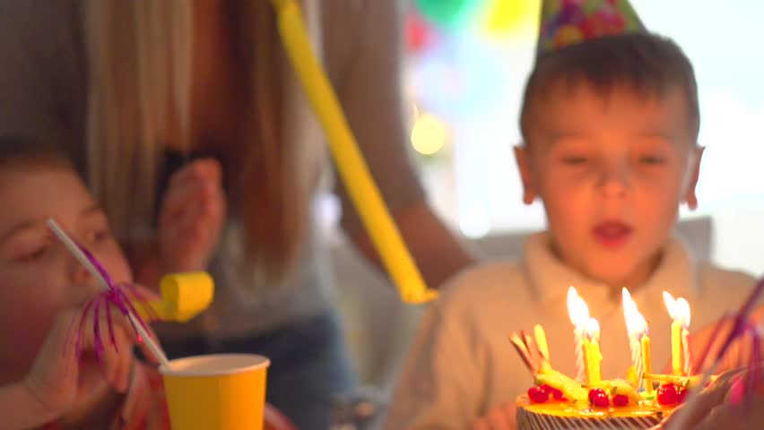 Little Boy Blows Out Candles On Birthday Cake At Party Happy Big Family Celebrating Of Kid Slow Motion 240 Fps High Speed Camera