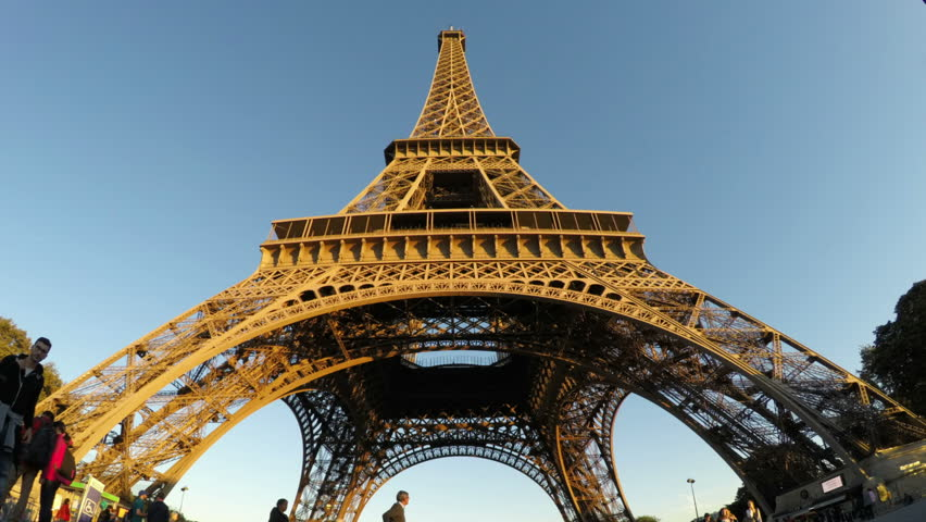 Paris, France - October 2, 2015: Eiffel Tower vertical panning time lapse with tourists around under nice evening lighting. | Shutterstock HD Video #12625034