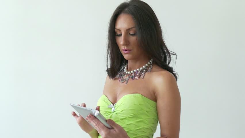 4K Young woman in green dress using tablet computer internet technology | Shutterstock HD Video #12636743