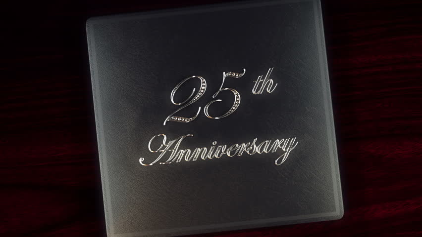 Tell your story with this 25th silver anniversary leather album with diamond inlays that opens and closes with a green screen to insert your picture or footage