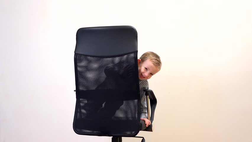 Child In Businessman Role Playing On Office Chair Stock Footage