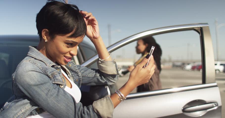 Image result for black woman smiling at her phone
