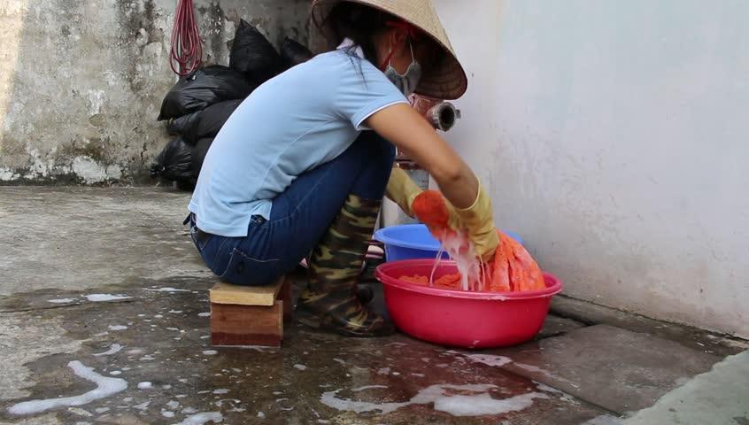 VASHISHT, INDIA - CIRCA MAY 2014: Unidentified Women Wash ...