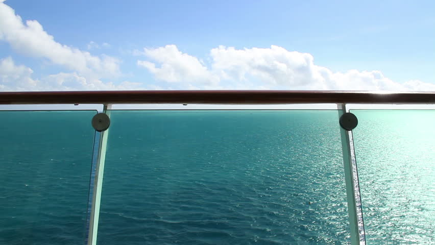 Looking over the banister at the ocean on a cruise liner.