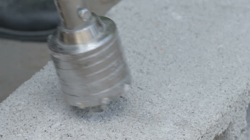 Drilling hole in concrete plank